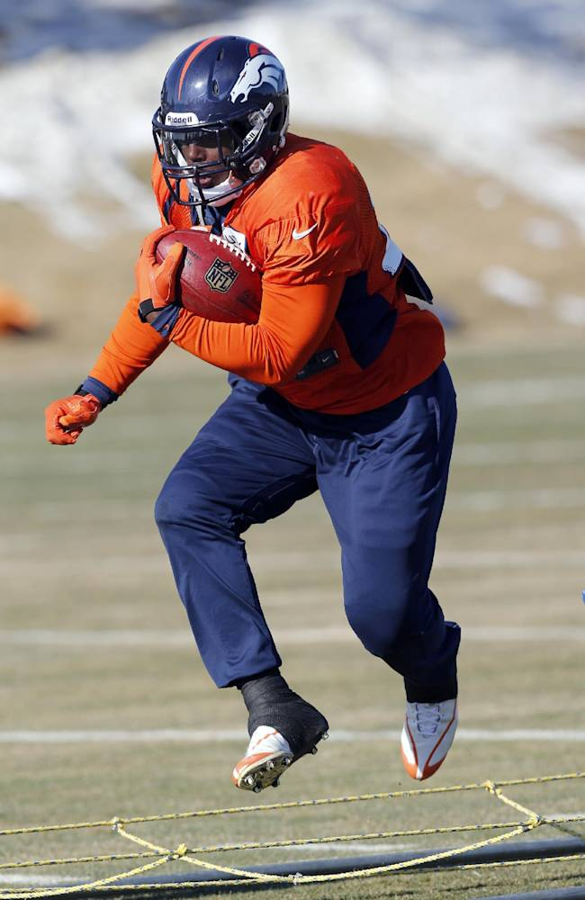Denver Broncos running back Knowshon Moreno (27) works out at practice for the football team's NFL playoff game against the San Diego Chargers at the Broncos training facility in Englewood, Colo., on Wednesday, Jan. 8, 2014. AP Photo/Ed Andrieski)