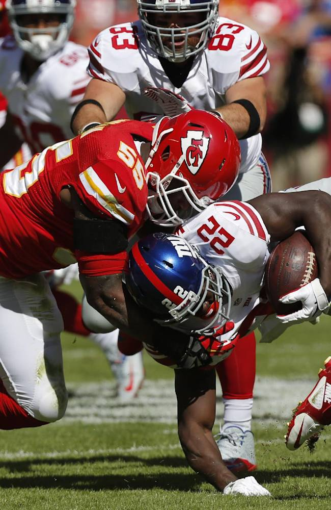 New York Giants running back David Wilson (22) is tackled by Kansas City Chiefs inside linebacker Akeem Jordan (55) during the first half of an NFL football game at Arrowhead Stadium in Kansas City, Mo., Sunday, Sept. 29, 2013