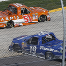 Tyler Reddick (19) spins out in front of Daniel Suarez (51) during the NASCAR Truck race at Martinsville Speedway, Saturday, March 28, 2015, in Martinsville, Va. (AP Photo/Steve Helber)