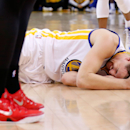 OAKLAND, CA - MAY 27: Klay Thompson #11 of the Golden State Warriors is injured in the fourth quarter against the Houston Rockets during game five of the Western Conference Finals of the 2015 NBA Playoffs at ORACLE Arena on May 27, 2015 in Oakland, California. (Photo by Ezra Shaw/Getty Images)