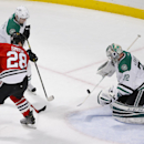 Dallas Stars goalie Kari Lehtonen (32) defends a shot by Chicago Blackhawks right wing Ben Smith (28) during the second period of an NHL hockey game, Sunday, Jan. 18, 2015, in Chicago The Associated Press
