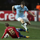 Manchester City's James Milner leaps over a challenge from CSKA's Dmitri Efremov during the Champions League Group E soccer match between CSKA Moscow and Manchester City at Arena Khimki stadium in Moscow, Russia, Tuesday Oct. 21, 2014