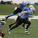 Detroit Lions receivers Golden Tate, top, Kevin Ogletree, center, and Kris Durham run through drills at the Lions training facility in Allen Park, Mich., Tuesday, April 22, 2014. (AP Photo/Carlos Osorio)