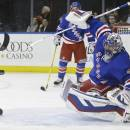 New York Rangers goalie Henrik Lundqvist (30), of Sweden, stops a shot on the goal during the first period of an NHL hockey game against the Washington Capitals, Tuesday, Dec. 23, 2014, in New York. (AP Photo/Frank Franklin II)