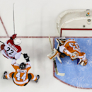 Carolina Hurricanes' Manny Malhotra, left, scores a goal on Philadelphia Flyers goalie Cal Heeter, right, as Kimmo Timonen watches during the first period of an NHL hockey game, Sunday, April 13, 2014, in Philadelphia The Associated Press