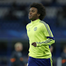 Chelsea's Willian warms up prior to the Group G Champions League match between Chelsea and Maribor at Stamford Bridge stadium in London, Britain, Tuesday, Oct. 21, 2014