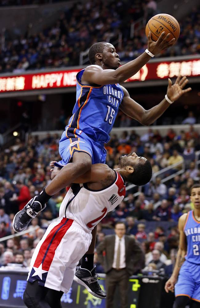 Washington Wizards guard John Wall (2) draws the charging foul from Oklahoma City Thunder guard Reggie Jackson (15) in the first half of an NBA basketball game on Saturday, Feb. 1, 2014, in Washington