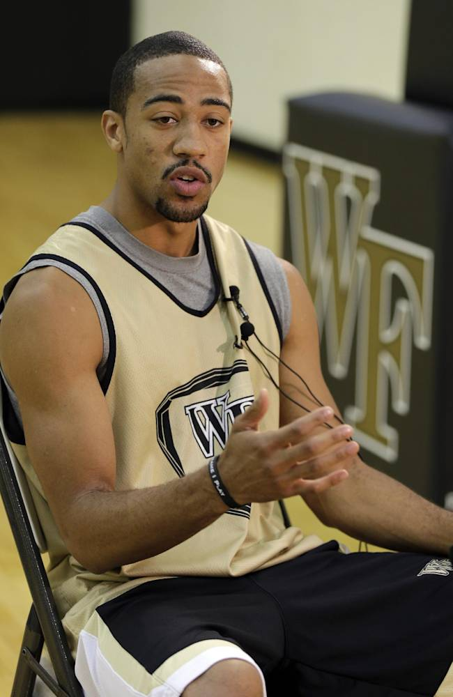 Wake Forest's Coron Williams answers a question from the media during NCAA college basketball media day in Winston-Salem, N.C., Tuesday, Oct. 8, 2013