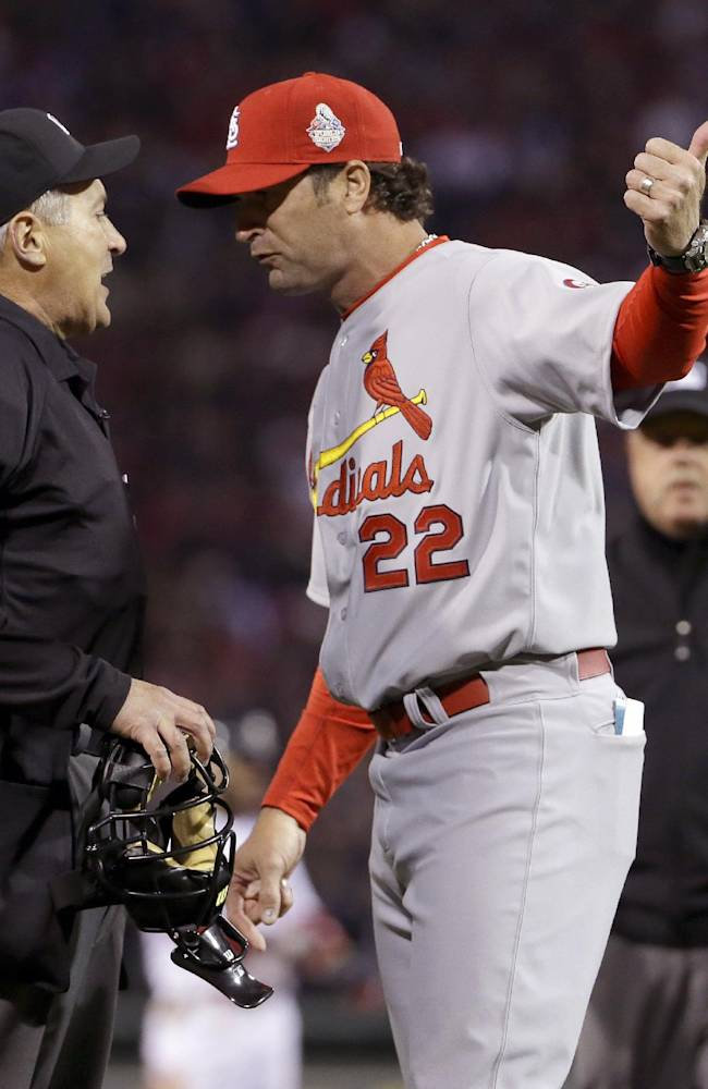 St. Louis Cardinals manager Mike Matheny argues a call with umpire John Hirschbeck during the first inning of Game 1 of baseball's World Series against the Boston Red Sox Wednesday, Oct. 23, 2013, in Boston