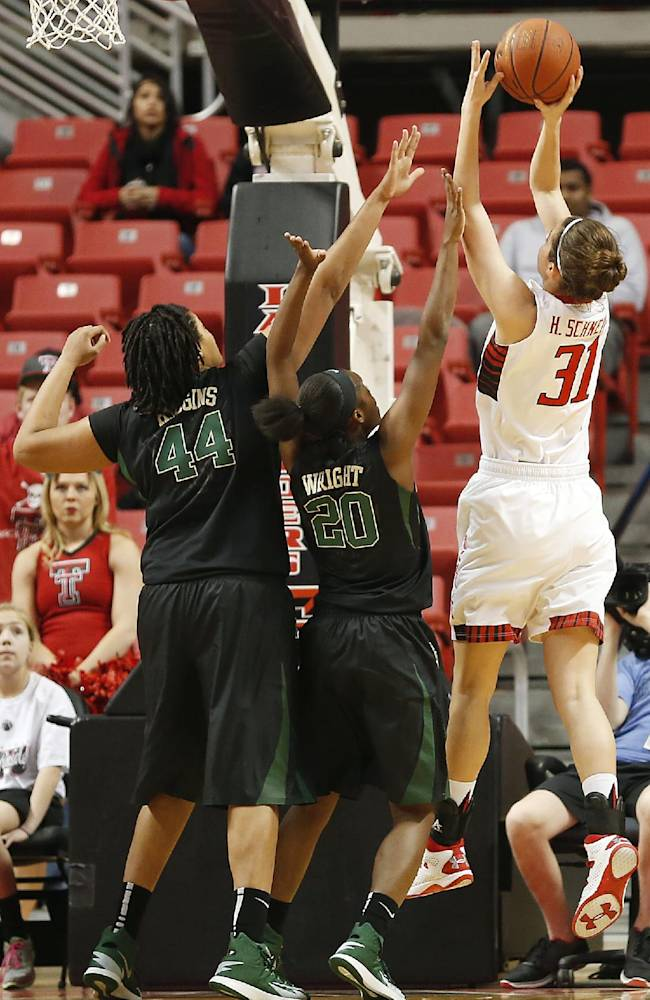 Texas Tech's Haley Schneider (31) scores over Baylor's Kristina Higgins (44) and Imani Wright (20) during an NCAA college basketball game in Lubbock, Texas, Wednesday, Feb. 12, 2014
