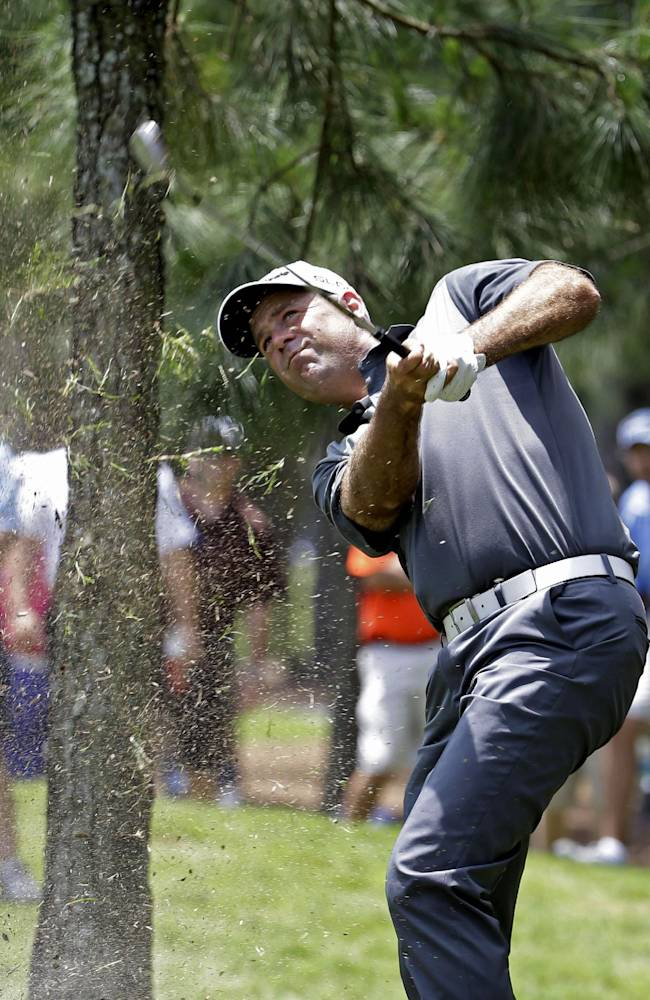 Stewart Cink hits from the rough on the first hole during the third round of The Players championship golf tournament at TPC Sawgrass, Saturday, May 10, 2014, in Ponte Vedra Beach, Fla
