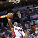 Miami Heat guard Mario Chalmers (15) goes up for a shot against New York Knicks forward Amar'e Stoudemire (1) during the first half of an NBA basketball game, Sunday, April 6, 2014, in Miami The Associated Press