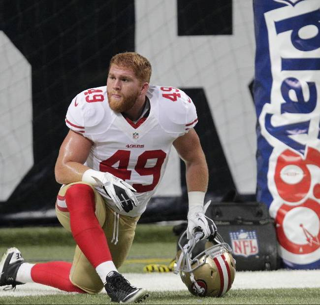 San Francisco 49ers fullback Bruce Miller (49) warms up before the start of an NFL football game between the St. Louis Rams and the San Francisco 49ers Sunday, Dec. 2, 2012, in St. Louis