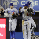 Los Angeles Dodgers' Yasiel Puig (66), Skip Schumaker (3) and Andre Ethier (16), celebrate after the second baseball game of a doubleheader against the New York Yankees Wednesday, June 19, 2013, in New York. The Dodgers won the game 6-0. (AP Photo/Frank Franklin II)