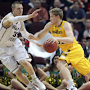 San Francisco's Tim Derksen drives past BYU's Nate Austin during the second half of a West Coast Conference tournament NCAA college basketball game Monday, March 10, 2014, in Las Vegas. BYU defeated San Francisco 79-77 in overtime The Associated Press