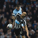 Manchester City's Aleksander Kolarov, top, fights for the ball against Newcastle's Gabriel Obertan during the English League Cup soccer match between Manchester City and Newcastle at the Etihad Stadium, Manchester, England, Wednesday Oct. 29, 2014