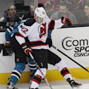 New Jersey Devils' Eric Gelinas, front, collides with San Jose Sharks' Logan Couture during the first period of an NHL hockey game, Saturday, Nov. 23, 2013 i San Jose, Calif The Associated Press