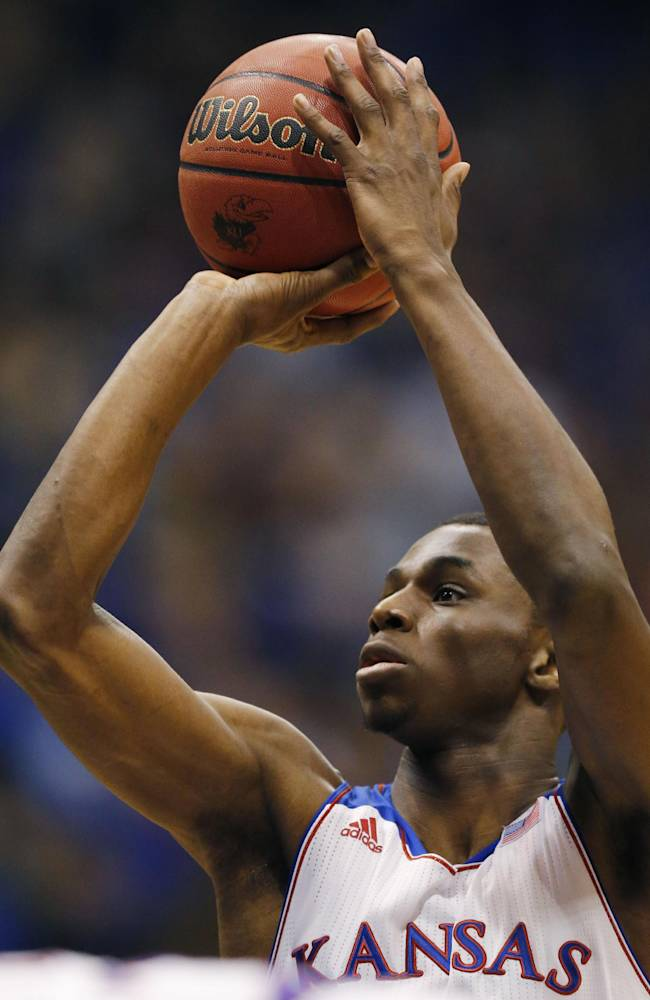 Kansas guard Andrew Wiggins shoots a free throw during the first half of an NCAA college basketball game against Toledo in Lawrence, Kan., Monday, Dec. 30, 2013. Kansas won 93-83