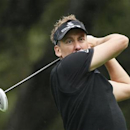 Ian Poulter of Britain tees off on the sixth hole during the final round of the World Challenge golf tournament in Thousand Oaks, California, December 2, 2012. REUTERS/Lucy Nicholson