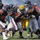 Green Bay Packers wide receiver Randall Cobb (18) is stopped by Chicago Bears defenders in the first half of an NFL football game Sunday, Sept. 28, 2014, in Chicago. The Associated Press