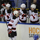 New Jersey Devils' Jaromir Jagr (68) is congratulated by Ryan Carter (20) after Jagr scored his 700th goal in the second period of an NHL hockey game against the New York Islanders on Saturday, March 1, 2014, in Uniondale, N.Y The Associated Press