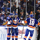 New York Islanders center John Tavares (91), defenseman Nick Leddy (2) and center Ryan Strome (18) celebrate Tavares' goal against the Washington Capitals during the first period in Game 6 in the first round of the NHL hockey Stanley Cup playoffs at Nassau Coliseum on Saturday, April 25, 2015, in Uniondale, N.Y. (AP Photo/Kathy Kmonicek)