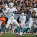 Miami Dolphins quarterback Ryan Tannehill (17) throws a touchdown pass to tight end Charles Clay during the first half of an NFL football game against the Chicago Bears Sunday, Oct. 19, 2014 in Chicago The Associated Press