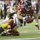 Atlanta Falcons tight end Tony Gonzalez (88) is stopped near the goal line by Washington Redskins cornerback Josh Wilson (26) during the second half of an NFL football game, Sunday, Dec. 15, 2013, in Atlanta. (AP Photo/John Bazemore)