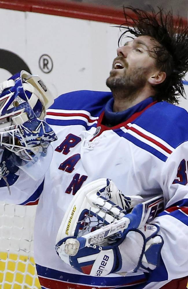New York Rangers goalie Henrik Lundqvist (30) collects himself after allowing a goal by Pittsburgh Penguins' Jussi Jokinen in the third period of game 2 of a second-round NHL playoff hockey series in Pittsburgh Sunday, May 4, 2014. The Penguins won 3-0, to even the series at 1-1