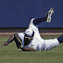 Milwaukee Brewers' Elian Herrera cannot catch a ball hit by San Diego Padres' Xavier Nady during the first inning of an exhibition spring training baseball game on Friday, March 7, 2014, in Phoenix The Associated Press