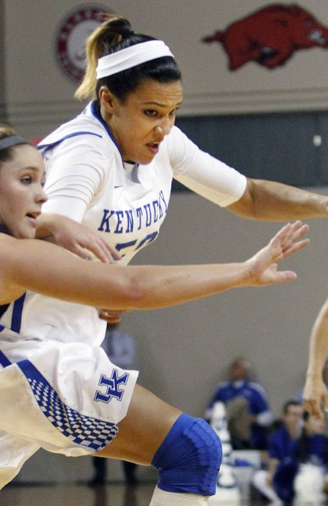 Kentucky's Azia Bishop, right, and Lipscomb's Kelli Smith chase a loose ball during the first half of an NCAA college basketball, Thursday, Nov. 21, 2013, in Lexington, Ky