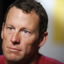 FILE - In this Feb. 15, 2011 file photo, Lance Armstrong pauses during an interview in Austin, Texas. Two of Lance Armstrong's longtime business partners have agreed to pay the federal government $500,000 to settle a whistleblower lawsuit filed by a former teammate, Floyd Landis, Friday, Dec. 19, 2014. (AP Photo/Thao Nguyen, File)