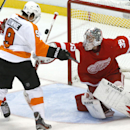 Detroit Red Wings goalie Jimmy Howard (35) stops a Philadelphia Flyers right wing Steve Downie (9) shot in the third period of an NHL hockey game in Detroit, Wednesday, Dec. 4, 2013 The Associated Press