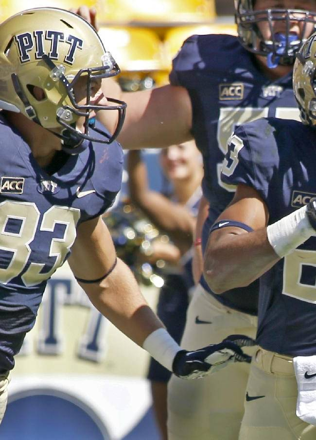 Pittsburgh wide receiver Tyler Boyd (23) celebrates with tight end Scott Orndoff (83) and other teammates after making a touchdown catch in the second quarter of the NCAA football game against New Mexico on Saturday, Sept. 14, 2013, in Pittsburgh