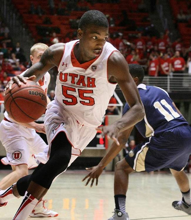 Utah guard Delon Wright (55) drives into the paint during the second half against UC Davis during an NCAA college basketball game Friday, Nov. 15, 2013, in Salt Lake City