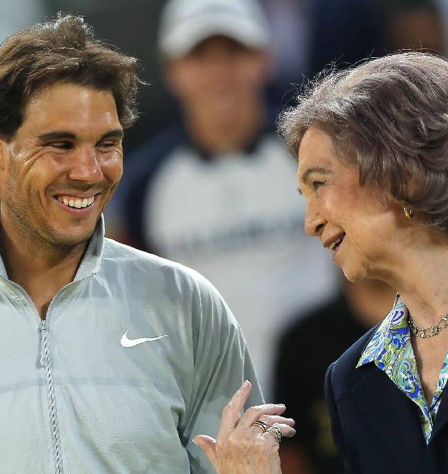 Rafael Nadal from Spain, left, laughs with Queen Sofia of Spain, after winning his Madrid Open tennis tournament final match against Kei Nishikori from Japan in Madrid, Spain, Sunday, May 11, 2014