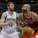 Chicago Bulls forward Carlos Boozer, right, looks to the basket past Minnesota Timberwolves forward Kevin Love during the first quarter of an NBA basketball game in Minneapolis, Wednesday, April 9, 2014 The Associated Press