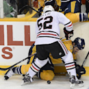 Chicago Blackhawks left wing Brandon Bollig (52) and Nashville Predators forward Paul Gaustad (28) vie for the puck against the boards in the second period of an NHL hockey game Saturday, Nov. 16, 2013, in Nashville, Tenn The Associated Press