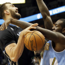 Minnesota Timberwolves' Nikola Pekovic, left, of Montenegro, gets tied up during a shot-attempt by Denver Nuggets' J.J. Hickson in the first quarter of an NBA basketball game on Wednesday, Nov. 27, 2013, in Minneapolis. (AP Photo/Jim Mone)