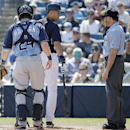 New York Yankees batter Derek Jeter, center, questions a call by home plate umpire Dan Iassogna, right, after Iassogna called him out on strikes during a spring training baseball game against the Tampa Bay Rays in Tampa, Fla., Sunday, March 9, 2014. Rays
