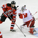New Jersey Devils' Patrik Elias, left, of the Czech Republic, watches the puck go over Detroit Red Wings goaltender Jimmy Howard for a goal by Devils' Marek Zidlicky (not shown) during the third period of an NHL hockey game Tuesday, March 4, 2014, in Newa