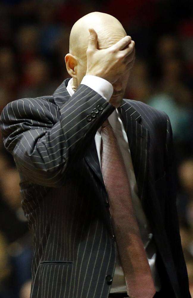 Mississippi basketball coach Andy Kennedy reacts to his team's play against Florida in the second half of an NCAA college basketball game in Oxford, Miss., Saturday, Feb. 22, 2014. Florida won 75-71