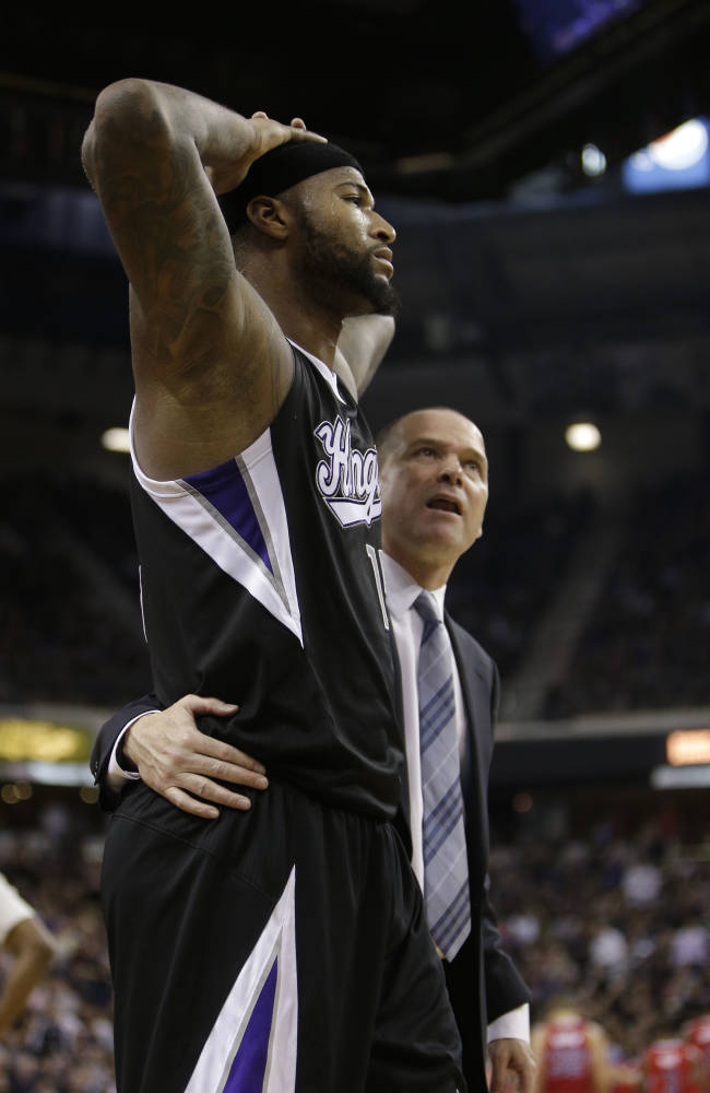 Sacramento Kings center DeMarcus Cousins, left, is walked off the court by head coach Michael Malone after he was called for a technical foul during the fourth quarter of an NBA basketball game against the Los Angeles Clippers in Sacramento, Calif., Friday, Nov. 1, 2013.  The Clippers won 110-101