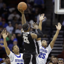 Providence forward LaDontae Henton (23) shoots as he splits Seton Hall defenders Desi Rodriguez (20) and Rashed Anthony (25) during the second half of an NCAA college basketball game Wednesday, March 4, 2015, in Newark, N.J. Providence won 79-66. (AP Photo/Mel Evans)