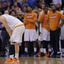 Phoenix Suns' Goran Dragic, of Slovenia, rests as his bench watches a free throw during the second half of an NBA basketball game against the Memphis Grizzlies, Monday, April 14, 2014, in Phoenix. The Grizzlies won 97-91 The Associated Press