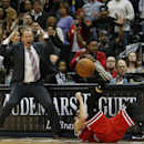 Atlanta Hawks head coach Mike Budenholzer reacts as Chicago Bulls shooting guard Kirk Hinrich (12) falls to the floor after being fouled by Hawks' DemArre Carroll in the final moments of the second half of an NBA basketball game, Tuesday, Feb. 25, 2014, i