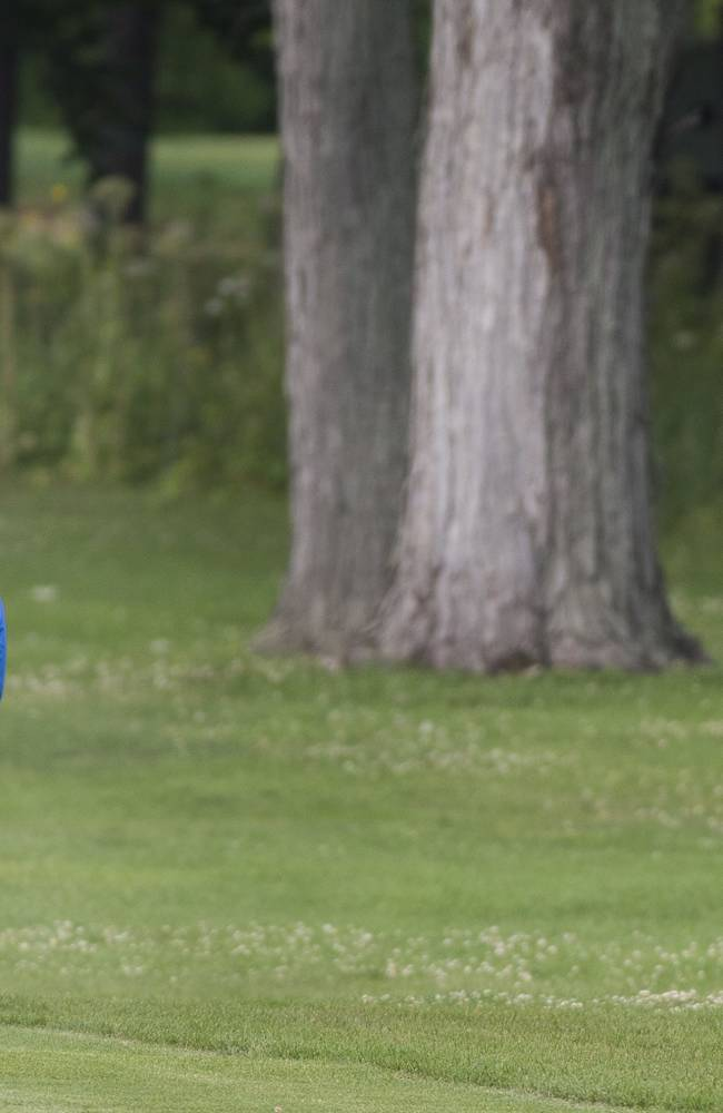 Jamie Lovemark, from the United States, plays a shot from the 18th fairway during the third round of the Canadian Open golf championship at the Royal Montreal Golf Club in Montreal, Saturday, July 26, 2014