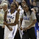 Duke's Chelsea Gray, right, and Elizabeth Williams, left, cheer after Duke's win over North Carolina in an NCAA college basketball semi-final game at the Atlantic Coast Conference tournament in Greensboro, N.C., Saturday, March 8, 2014. Duke won 66-61