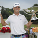 Bill Horschel poses with both trophies after winning the Tour Championship golf tournament and The FedEX Cup, Sunday, Sept 14, 2014, in Atlanta. (AP Photo/John Amis)