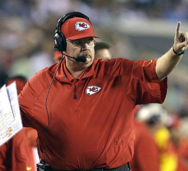 Kansas City Chiefs coach Andy Reid calls a play during the second half of an NFL football game against the Philadelphia Eagles, Thursday, Sept. 19, 2013, in Philadelphia